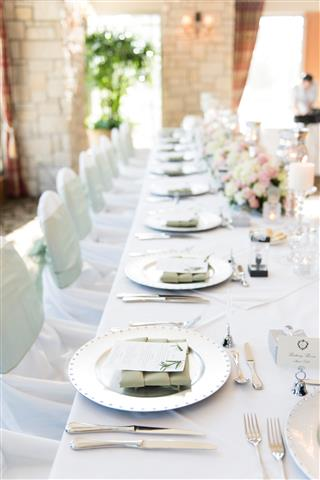 Classic white bridal party table setup