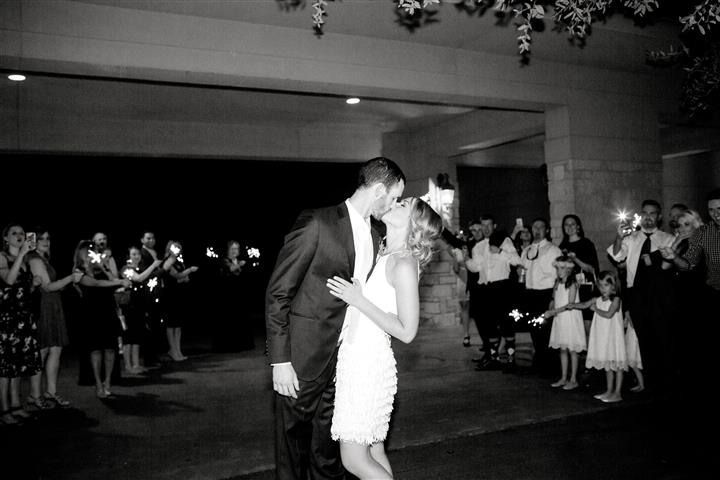 Groom and bride kissing while dancing